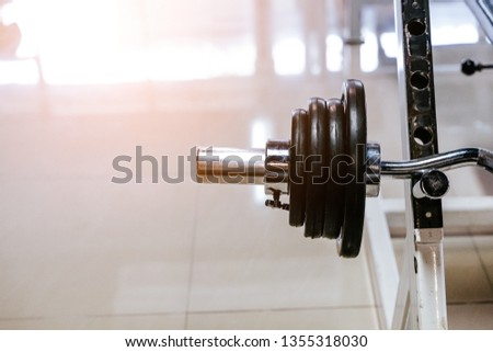 Fitness equipment for workout in Gym. Barbell with weights plate on floor. close up barbell.