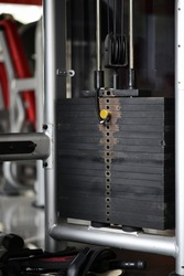 Fitness equipment for workout. Weight plate , machine weight , old cable machine.