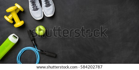 Fitness equipment on a dark background with copy space