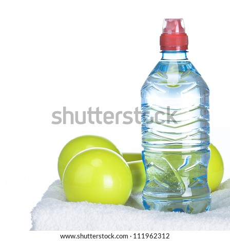 Fitness equipment towel, water, dumbbell - stock photo