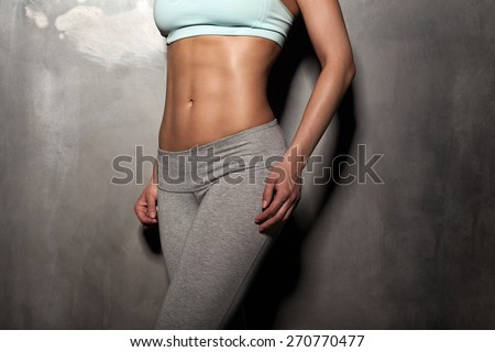 Fitness female woman with muscular body, do her workout, abs, abdominals