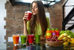 Fitness Food. Healthy Eating Woman On Diet Drinking Fresh Detox Juice, Smoothie For Breakfast. Closeup Of Beautiful Smiling Girl With Fruits And Weight Loss Drinks At Kitchen Table. Nutrition Concept