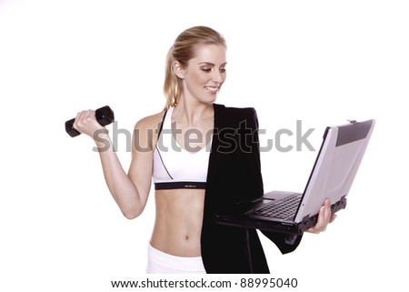 Fitness for businesswoman.  A young blond businesswoman doing exercise.