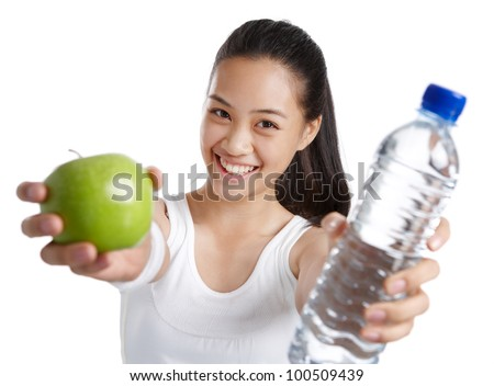 fitness girl holding green apple and water bottle