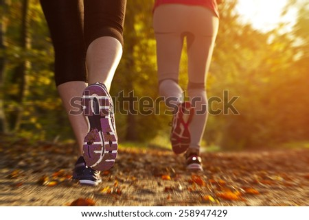 Fitness Girl running at sunset in forest #258947429