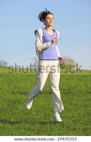 Fitness Girl running in the park