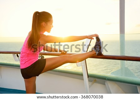 fitness girl stretching leg on cruise vacation young