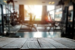 fitness gym and wooden table space in morning light