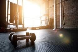 Fitness gym background with sports equipment for workout