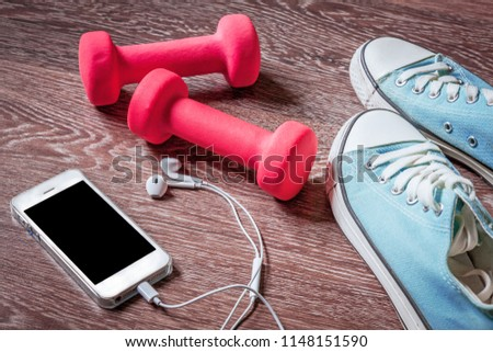 Fitness gym equipment. Sneakers, dumbbells with phone. Workout footwear. Sport trainers and music headphones. #1148151590