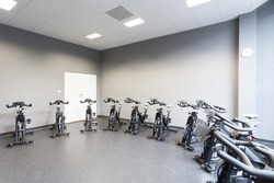 Fitness gym interior with a stationary bicycles