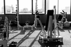 Fitness machines in fitness room at the evening. Modern gym interior with equipment.fitness center interior. black and white