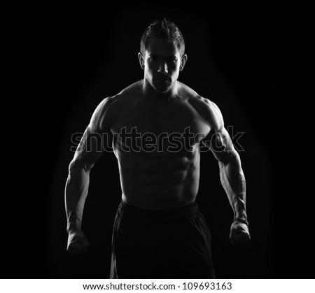 Fitness male on black
