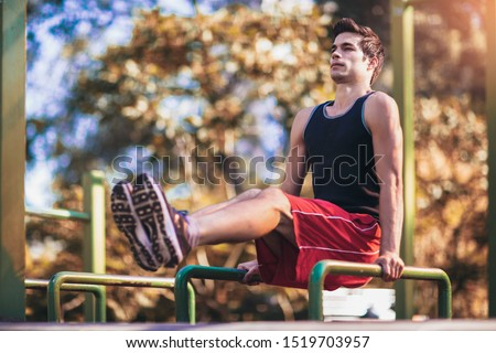 Fitness man doing workouts outdoors
