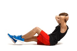 Fitness man with perfect body doing abdominal exercises isolated on a white background.  Fitness man with perfect body doing abdominal exercises isolated on a white background.