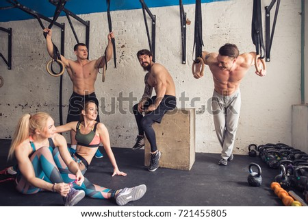 fitness models resting in the gym after workout