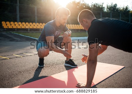fitness outdoor workout with trainer; morning exercises with personal coach;