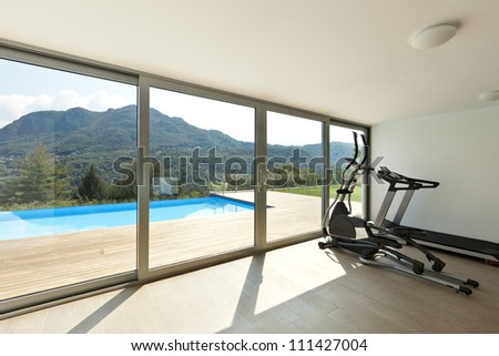Fitness room with pool view