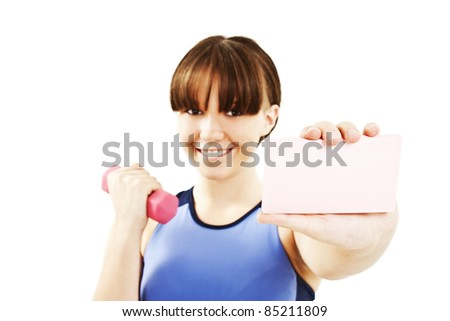 Fitness sign woman smiling happy showing empty blank paper sign. Fitness model isolated on white background.