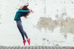 Fitness sport girl in fashion sportswear dancing hip hop in the street, outdoor sports, urban style