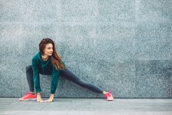 Fitness sport girl in fashion sportswear doing yoga fitness exercise in the street, outdoor sports, urban style