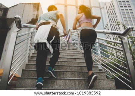 fitness, sport, people and lifestyle concept - happy couple running outdoors. #1019385592