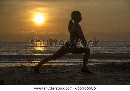 Stock Photo Fitness, sport, people and lifestyle concept Silhouette woman yoga on the beach at sunset.
