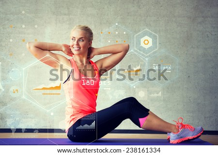 Stock Photo fitness, sport, training, future technology and lifestyle concept - smiling woman doing exercises on mat in gym over graph projection