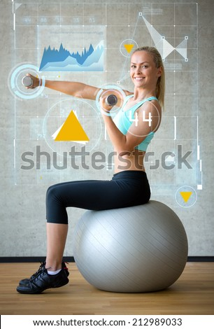 fitness, sport, training, future technology and lifestyle concept - smiling woman with dumbbells and exercise ball in gym and graph projection