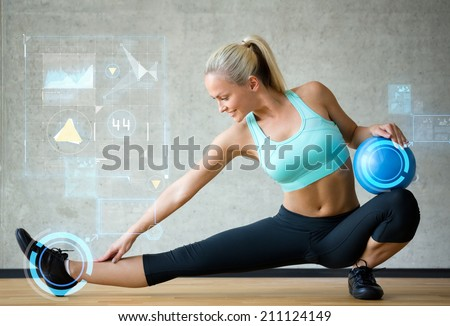 fitness, sport, training, future technology and lifestyle concept - smiling woman with exercise ball in gym over graph projection