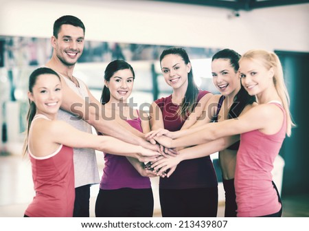fitness, sport, training, gym and lifestyle concept - group of happy people in the gym celebrating victory