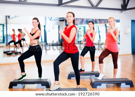 fitness sport training gym and lifestyle concept group of smiling people doing aerobic