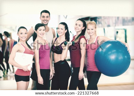 fitness, sport, training, gym and lifestyle concept - group of smiling people in the gym