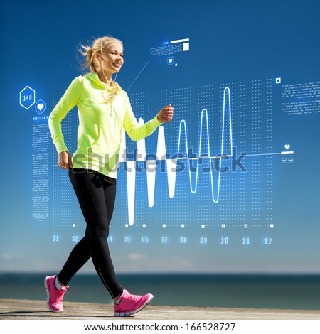 fitness, sport, training, technology and lifestyle concept - woman doing sports outdoors with earphones