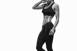 Fitness sporty woman showing her well trained body. Strong abs showing.