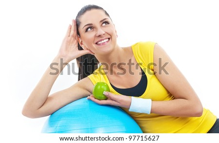 Fitness time, young women holding apple. Isolated on white - stock photo