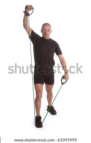 Fitness trainer exercising in gym