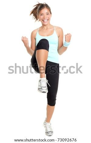Fitness woman aerobics. Fresh energetic female fitness instructor doing aerobics. Full body image of beautiful multiracial Chinese Asian / Caucasian female model isolated on white background.