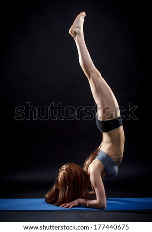 Fitness woman balance on hands