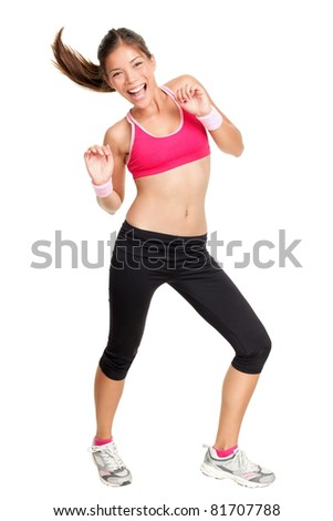 Fitness woman dancing isolated on white in full body. Beautiful, happy and smiling young female fitness instructor during dance class. Mixed race Caucasian Asian female fitness model.