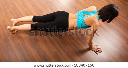 Fitness woman doing squats on the floor