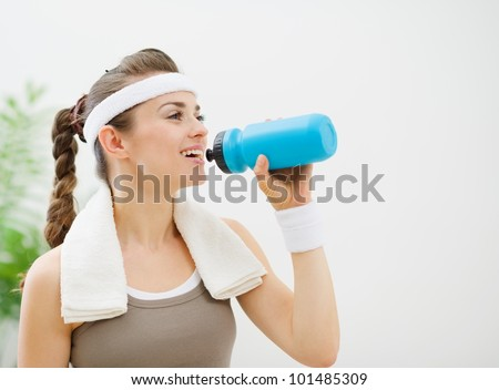 Fitness woman drinking water - stock photo