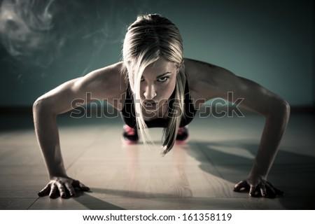 Fitness woman exercising push ups