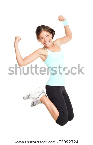 Fitness woman jumping excited isolated on white background Full body image of beautiful multiracial Asian Caucasian female model in jump flexing and showing muscles