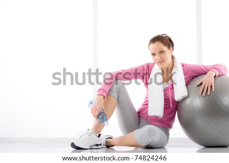 Fitness - woman relax with water bottle exercise ball