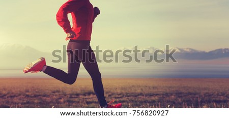 Fitness woman runner running on country road #756820927
