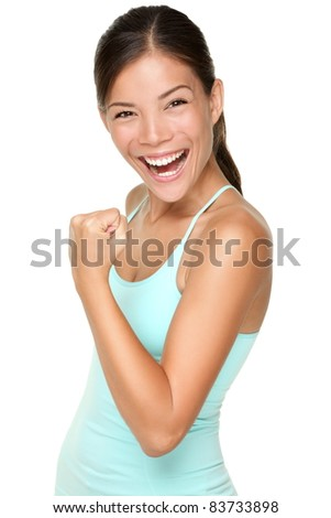 Fitness woman showing fresh energy flexing biceps muscles smiling happy isolated on white background. Beautiful fit mixed race Asian Caucasian female fitness model energetic and fun.
