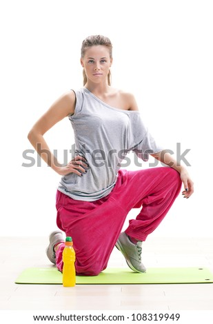 fitness woman sitting on the mat