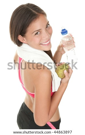 Fitness woman. Smiling happy asian fitness girl with water bottle and fruit. Gorgeous smiling mixed race chinese / caucasian model isolated on white background.