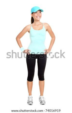 Fitness woman standing isolated on white background in full body. Young fresh and healthy mixed race Asian / Caucasian female model